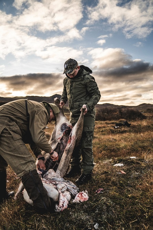 Two hunters recover bagged game in the Scottish Highlands