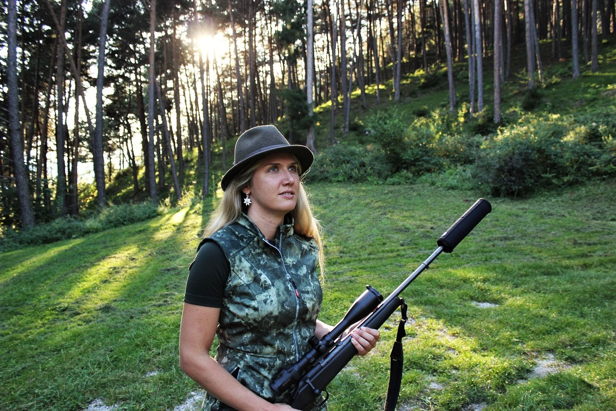 Antlerless deer hunting, Elena with rifle on hunting